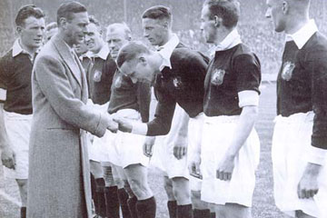 Sam Cowan introduces the future George VI to Matt Busby at the 1933 FA Cup Final