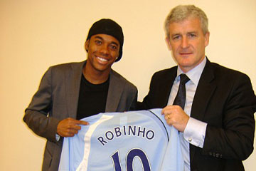 Robinho arrives for a British record transfer fee