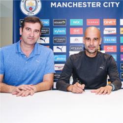 Guardiola signs new City contract